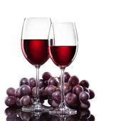 Red wine in glasses with grape isolated on white — Stock Photo