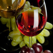 Stock Photo: Red and white wine in glasses with grape. Top view