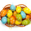 Color easter eggs in basket isolated on white. top view — Stockfoto