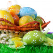 Royalty-Free Stock Photo: Color easter eggs in basket isolated on white