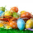 Color easter eggs in basket isolated on white — Stok fotoğraf