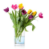 Bouquet from tulips in glass vase isolated on white — Stock Photo