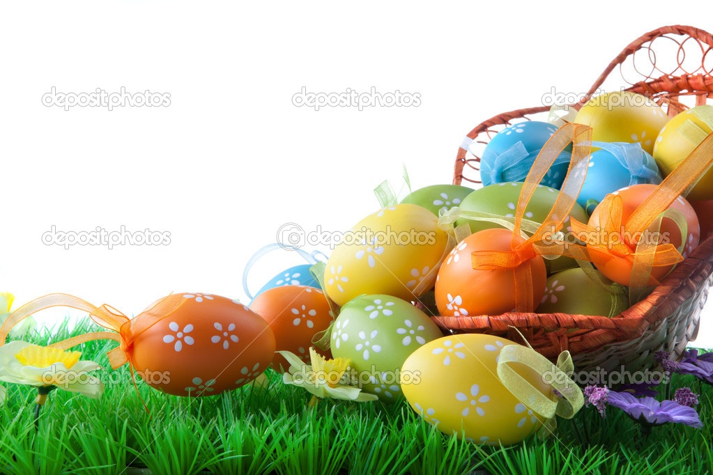 Color easter eggs in basket isolated on white — Stock Photo #5574743