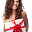 Naked smiling woman holding gift isolated on white — Stockfoto