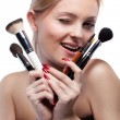 Young smiling womwith make up brushes isolated on white — Stock Photo #5678356