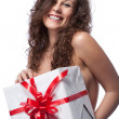 Portrait of nude smiling woman with gift isolated on white — Stock Photo