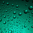 Stock Photo: Water drops on green