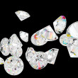 Foto Stock: Diamonds or gemstones isolated on black