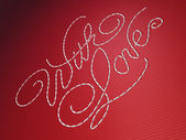 With love embroidery words on red — Stock Photo