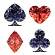 Red and dark blue diamond shaped card suits - Stock Photo