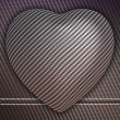 Carbon fibre heart on stetiched background - Stock Photo