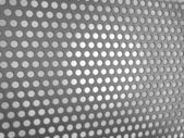 Carbon fibre surface with holes — Stock Photo