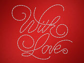 With love stitched embroidery words — Stock Photo