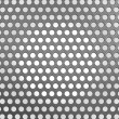 Carbon fibre surface with holes — Stock Photo #5543741