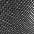 Pimply Carbon fibre with shallow DOF — Stock Photo #5543790