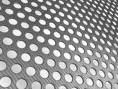 Carbon fibre surface perforated — Stock Photo