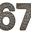Alligator skin font 6 7 digits - Lizenzfreies Foto