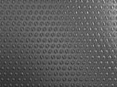 Carbon fibre background with round shapes — Stock Photo
