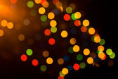Festive colorful lights over black — Stock Photo