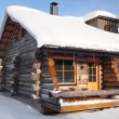 Traditional snow covered log cabin — Stock Photo