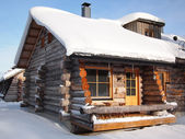 Traditional snow covered log cabin — Стоковое фото