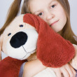 Stock Photo: Girl with toy dog