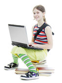 Teenage girl with a laptop — Stock Photo
