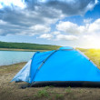 Tent by the lake — Stock Photo