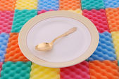 Plate with the gold spoon — ストック写真
