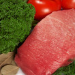 Stock Photo: Raw fresh meat with tomato