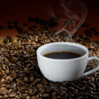 Coffee cup with roasted beans — Stock Photo #5533558