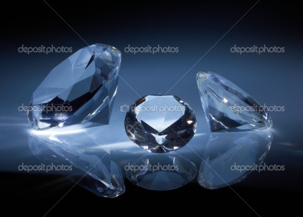 Shiny diamonds jewel on dark blue background  Stock Photo #5533719
