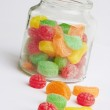 Colorful candy in glass jar — Stock Photo
