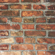 Old wall made from red bricks - Stock Photo