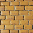 Old wall made from yellow bricks - Stock Photo
