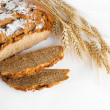 Stock Photo: Bread and stalks of wheat