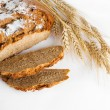 Bread and stalks of wheat — Stock Photo