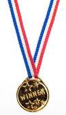 Wstążka złota zwycięzca metalowe — Zdjęcie stockowe