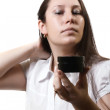 Woman and a cosmetic cream — Stock Photo