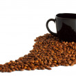 Black cup and coffee beans — Stock Photo
