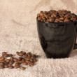Mug with coffee beans — Stock Photo