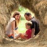 Happy Family in haystack — Stock Photo