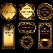 Stock Vector: Vintage set ornate gold labels