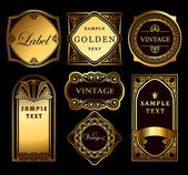 Vintage set ornate gold labels — Vector de stock