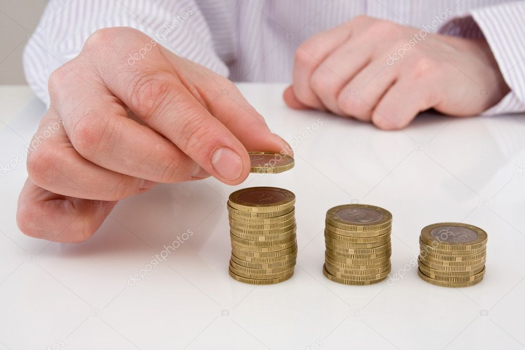 Human hand putting coin to money staircase — Stock Photo #5496005