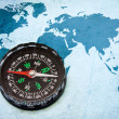 Compass on the blue world map. — Stock Photo #5576692