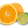 Orange fruits and green lemons. — Stock Photo