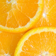 Stock Photo: Orange fruits slices.