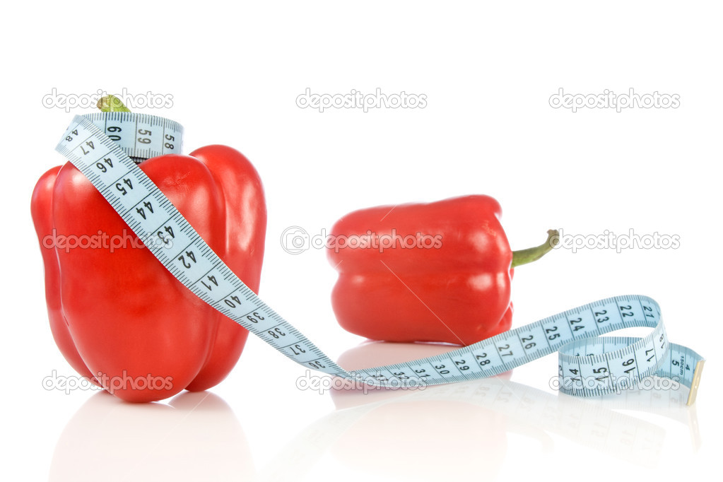 Peppers with measuring tape over a white background. — Stock Photo #5934584