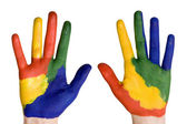 Child hands painted in colorful paints. — Stock Photo